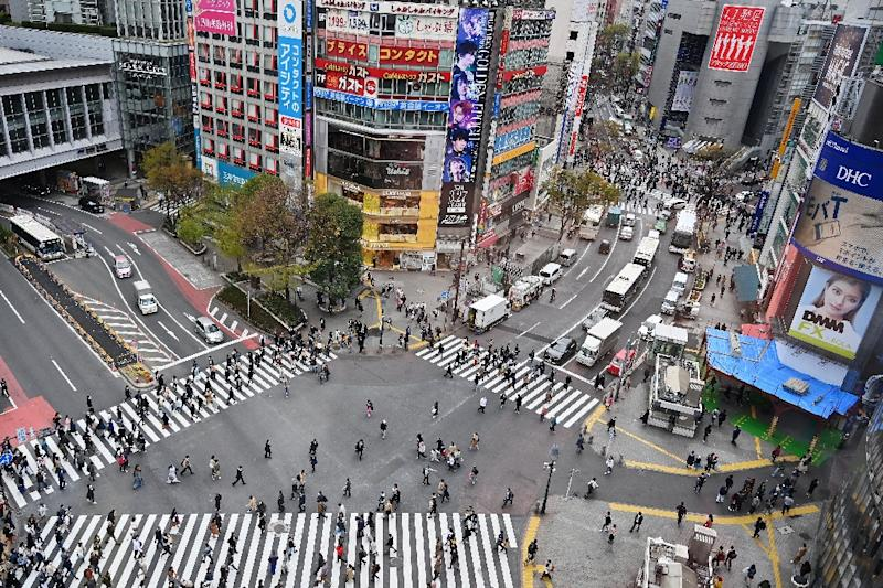 Pedestrians stroll the Shibuya crossing in Tokyo, where fears are high of cyber attacks (AFP Photo/CHARLY TRIBALLEAU)