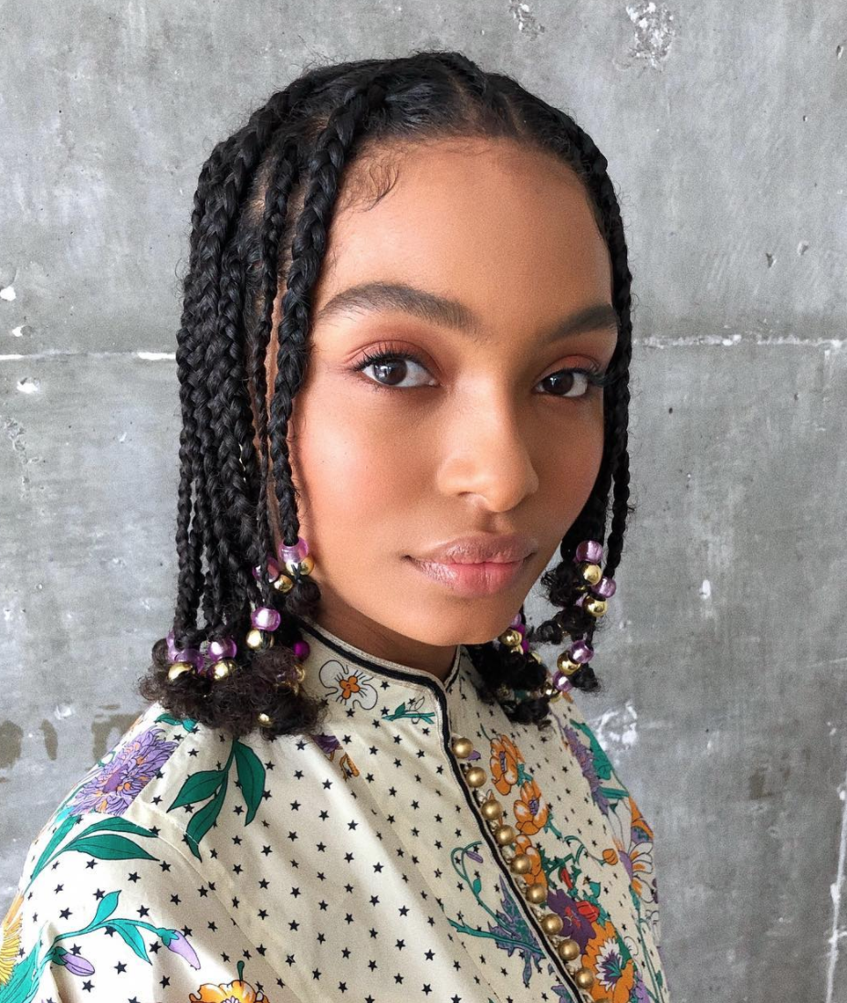 """There are endless ways to style a <a href=""""https://www.glamour.com/gallery/bob-braid-hairstyle-ideas?mbid=synd_yahoo_rss"""" rel=""""nofollow noopener"""" target=""""_blank"""" data-ylk=""""slk:braided bob hairstyle"""" class=""""link rapid-noclick-resp"""">braided bob hairstyle</a>. One of our favorites? Add multicolored beads to the ends to give the overall look a younger, more playful vibe."""