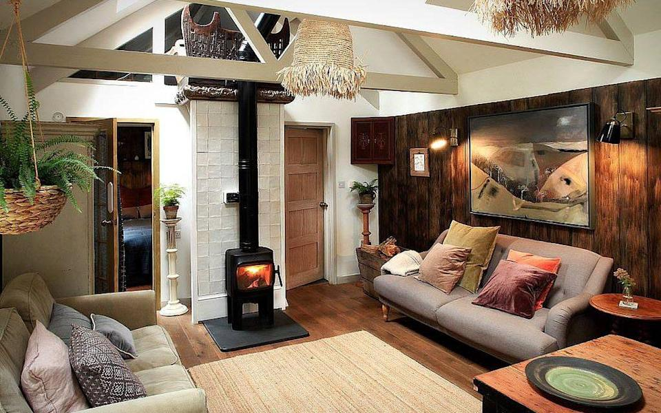 The wood burner at The Batman's Summerhouse is a welcome treat - Canopy and Stars