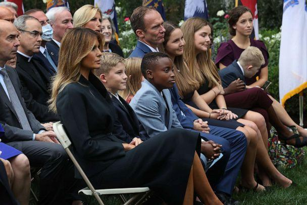 First lady Melania Trump sits next to Judge Amy Coney Barrett's family,including husband Jesse Barrett and their children, as President Donald Trump announces Barrett's nomination to the Supreme Court in the Rose Garden at the White House, Sept. 26, 2020. (Chip Somodevilla/Getty Images)