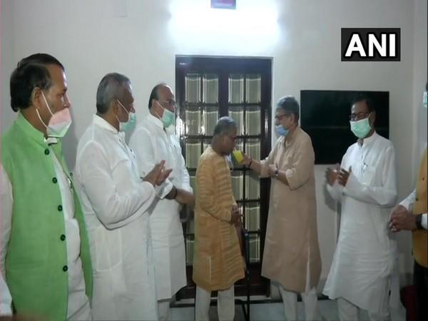 JD(U) MP Rajiv Ranjan Singh offering juice to Rajya Sabha Deputy Speaker Harivansh on Wednesday. (Photo/ANI)