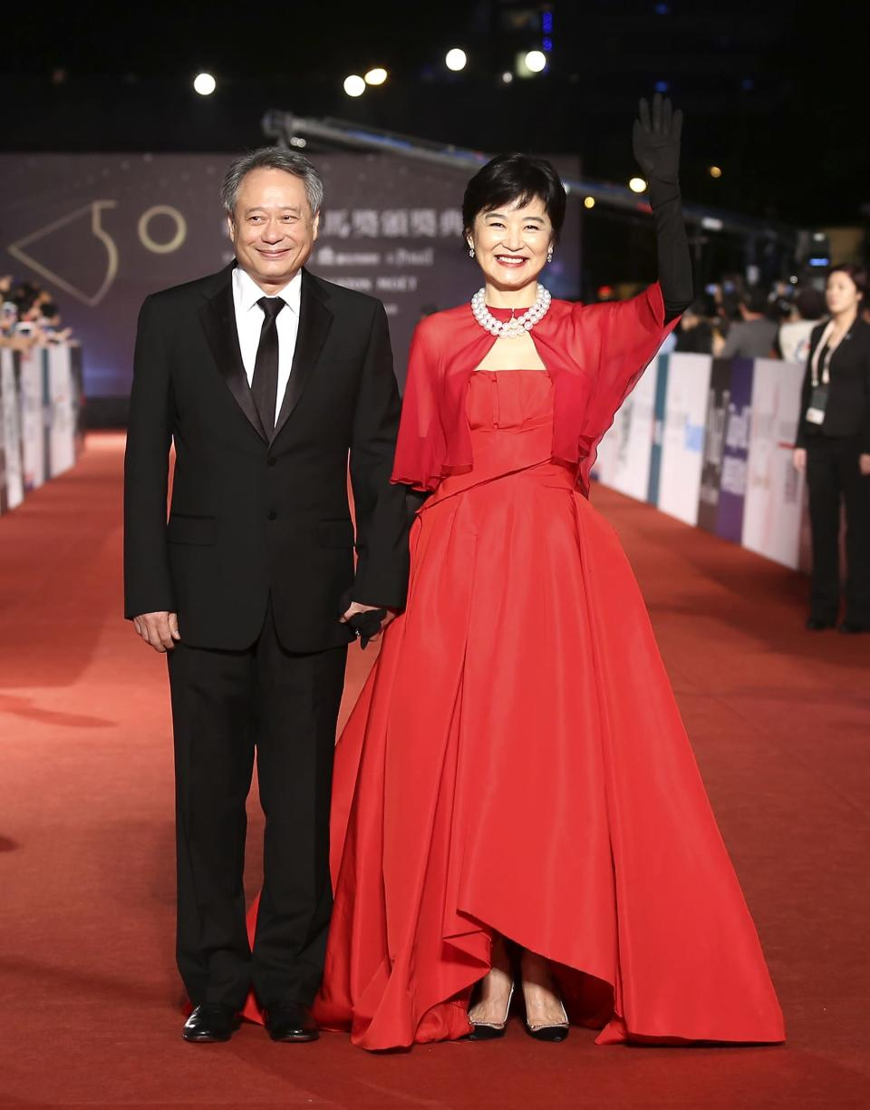 Taiwanese-born director Ang Lee (L) and Taiwanese actress Brigitte Lin pose for photographers on the red carpet at the 50th Golden Horse Film Awards in Taipei November 23, 2013. REUTERS/Patrick Lin (TAIWAN - Tags: ENTERTAINMENT)