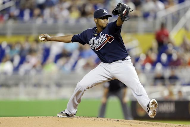 Atlanta Braves starting pitcher Julio Teheran throws in the first inning of a baseball game against the Miami Marlins, Tuesday, Sept. 10, 2013, in Miami. (AP Photo/Lynne Sladky)