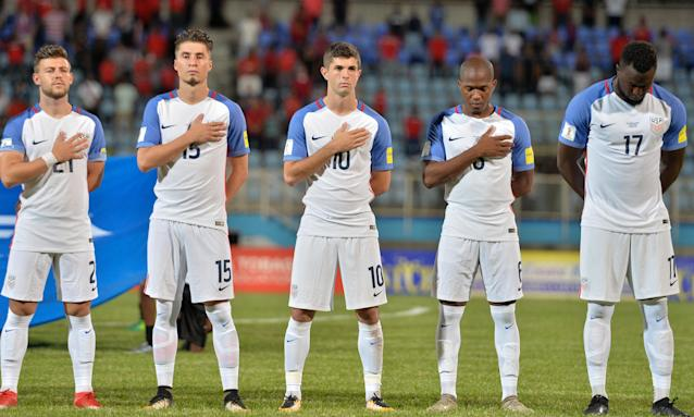 "<a class=""link rapid-noclick-resp"" href=""/soccer/players/christian-pulisic/"" data-ylk=""slk:Christian Pulisic"">Christian Pulisic</a> (center) must wait for an opportunity to appear at a World Cup. (The Guardian)"