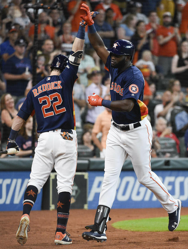 Houston Astros' Yordan Alvarez, right, celebrates his solo home run off Toronto Blue Jays starting pitcher Clayton Richard with Josh Reddick during the third inning of a baseball game, Saturday, June 15, 2019, in Houston. (AP Photo/Eric Christian Smith)
