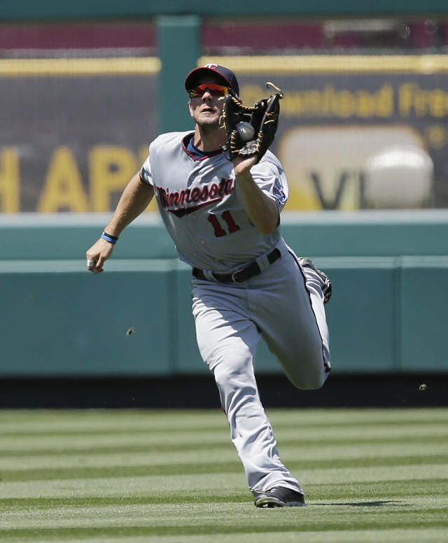 Minnesota Twins left fielder Clete Thomas catches a fly ball hit by Los Angeles Angels' J.B. Shuck during the fifth inning of a baseball game Wednesday, July 24, 2013, in Anaheim, Calif. (AP Photo/Jae C. Hong)
