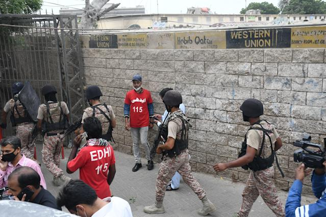 KARACHI, PAKISTAN - JUNE 29: Police officers inspect the site after gunmen attacked the Pakistani stock exchange building in Karachi, Pakistan on June 29, 2020. At least nine people were killed. The dead include four attackers, four Pakistan Stock Exchange security guards and a policeman, Muqaddas Haider, a city police chief, told reporters. At least seven people are also injured. (Photo by Sabir Mazhar/Anadolu Agency via Getty Images)