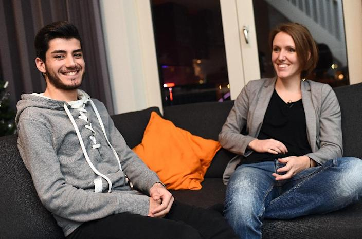 Omar, a 20-year-old Syrian gay refugee, pictured next to Lianda, a Dutch teacher who decided to host him at her home after hearing his story via socila networks about the abuses against gay migrants by fellow travellers, in Aalsmeer (AFP Photo/Emmanuel Dunand)
