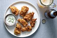 """These zesty chicken fingers get their flavor from a tangy buttermilk marinade and a breading spiked with smoked paprika. Be sure to plan ahead—these chicken pieces taste best when marinated for 24 hours before they are cooked. <a href=""""https://www.epicurious.com/recipes/food/views/buttermilk-fried-chicken-fingers-51258410?mbid=synd_yahoo_rss"""" rel=""""nofollow noopener"""" target=""""_blank"""" data-ylk=""""slk:See recipe."""" class=""""link rapid-noclick-resp"""">See recipe.</a>"""