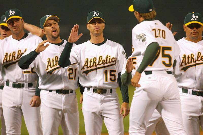 01 Apr 2002 : Tim Hudson #15 of the Oakland A's greets teammate Barry Zito #75 during the opening day game against the Texas Rangers at Network Associates Coliseum in Oakland, California. The A's won 8-3.DIGITAL IMAGE. Mandatory Credit: Tom Hauck/Getty Images