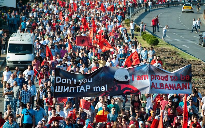 Ethnic Albanians wave flags and carry banners during a march in Skopje, Macedonia on June 13, 2015 (AFP Photo/Robert Atanasovski)