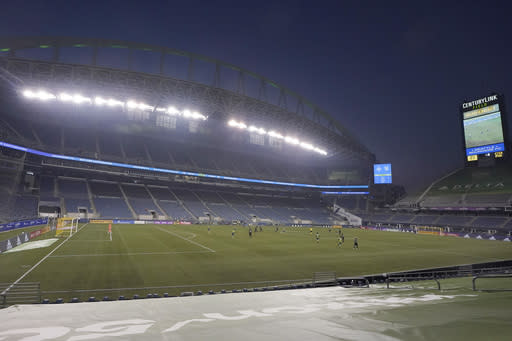Seattle Sounders and San Jose Earthquakes play under hazy conditions at CenturyLink Field during the first half of an MLS soccer match, Thursday, Sept. 10, 2020, in Seattle. Smoke from wildfires was in the air across the Seattle region. (AP Photo/Ted S. Warren)