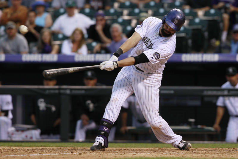 Colorado Rockies' Todd Helton hits a single to drive in two runs against the Arizona Diamondbacks in the ninth inning of the Diamondbacks' 13-9 victory in a baseball game in Denver on Sunday, Sept. 22, 2013. Helton, who announced that he will retire after 17 years with the Rockies at the end of the season, drove in four runs in the contest. (AP Photo/David Zalubowski)