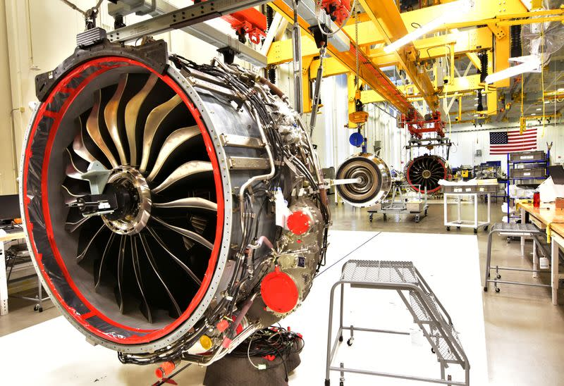 FILE PHOTO: Technicians build LEAP engines for jetliners at a new, highly automated General Electric (GE) factory in Lafayette