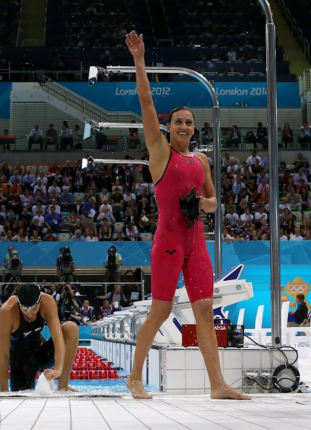 LONDON, ENGLAND - AUGUST 02: Rebecca Soni of the United States celebrates after winning gold and setting a new world record time of 2:19.59 in the Women's 200m Breaststroke Final on Day 6 of the London 2012 Olympic Games at the Aquatics Centre on August 2, 2012 in London, England. (Photo by Clive Rose/Getty Images)