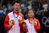 LONDON, ENGLAND - AUGUST 03: Silver medallists Chen Xu and Jin Ma of China hold their medals in the Mixed Doubles Badminton medal ceremony on Day 7 of the London 2012 Olympic Games at Wembley Arena on August 3, 2012 in London, England. (Photo by Michael Regan/Getty Images)