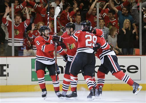 The Chicago Blackhawks celebrate after a goal against the Los Angeles Kings during the second period of Game 1 of the NHL hockey Stanley Cup Western Conference finals, Saturday, June 1, 2013, in Chicago. (AP Photo/Nam Y. Huh)