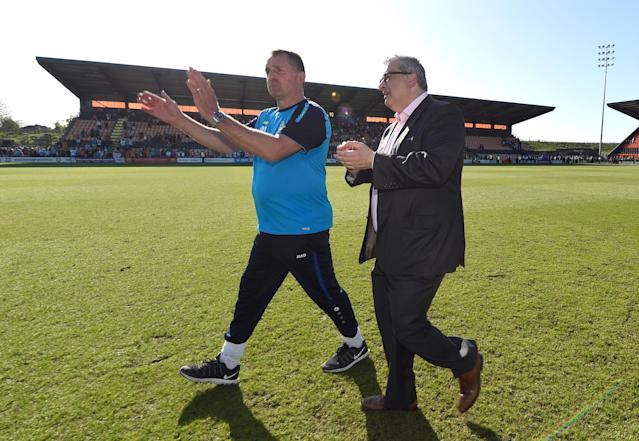 """Soccer Football - League Two - Barnet vs Chesterfield - The Hive, London, Britain - May 5, 2018 Barnet manager Martin Allen and chairman Anthony Kleanthous applaud their fans after the match as they are relegated from the Football League Action Images/Adam Holt EDITORIAL USE ONLY. No use with unauthorized audio, video, data, fixture lists, club/league logos or """"live"""" services. Online in-match use limited to 75 images, no video emulation. No use in betting, games or single club/league/player publications. Please contact your account representative for further details."""