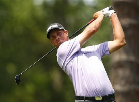 Harris English of the U.S. tees off on the second hole during the third round of the Players Championship PGA golf tournament at TPC Sawgrass in Ponte Vedra Beach, Florida May 12, 2012 file photo. REUTERS/Chris Keane