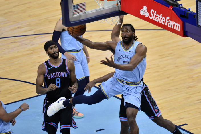 Memphis Grizzlies forward Justise Winslow (7) shoots the ball ahead of Sacramento Kings forward Maurice Harkless (8) in the first half of an NBA basketball game Friday, May 14, 2021, in Memphis, Tenn. (AP Photo/Brandon Dill)