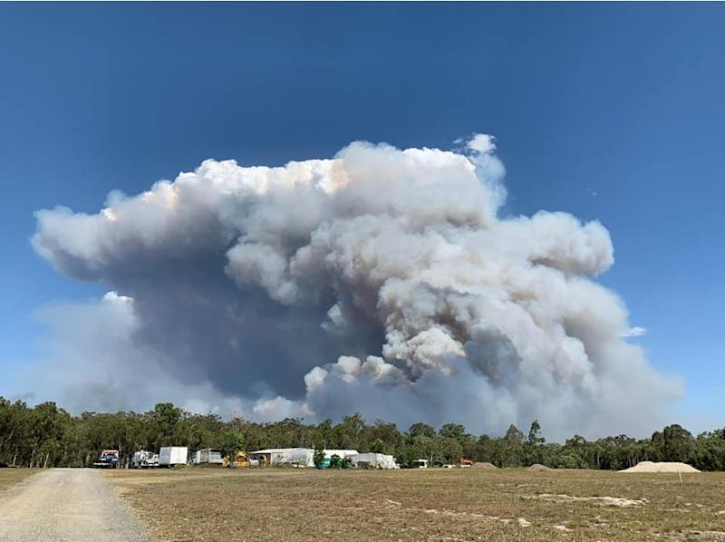 Smoke from Sunshine Coast fires in Queensland as hundreds are forced to evacuate.