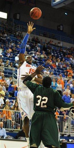 Florida's Will Yeguete (15) goes for two points with Mississippi Valley State's Paul Crosby (32) unable to block the shot during the first half of an NCAA college basketball game in Gainesville, Fla., Monday, Dec. 19, 2011. (AP Photo/Phil Sandlin)