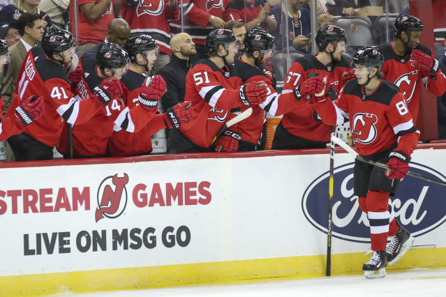New Jersey Devils center Jack Hughes celebrates after scoring a goal during the first period of the team's preseason NHL hockey game against the New York Rangers, Friday, Sept. 20, 2019, in Newark, N.J. (AP Photo/Mary Altaffer)