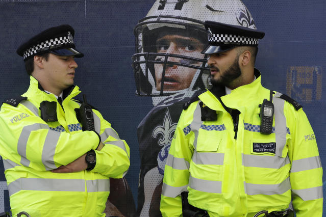 CORRECTS STADIUM TO TOTTENHAM HOTSPUR STADIUM INSTEAD OF WEMBLEY STADIUM - Police officers stand outside of Tottenham Hotspur Stadium before an NFL football game between the Chicago Bears and the Oakland Raiders, Sunday, Oct. 6, 2019, in London. (AP Photo/Kirsty Wigglesworth)