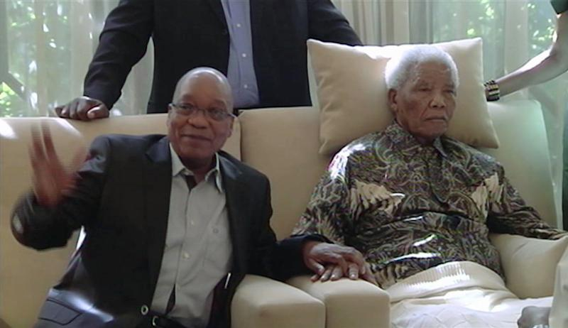 "FILE : In this image taken from video, South African President Jacob Zuma, left, sits with the ailing anti-apartheid icon Nelson Madela is filmed Monday April 29, 2013, more than three weeks after being released from hospital. Mandela was treated in hospital for a recurring lung infection.  South African President Jacob Zuma visited the former leader on April 29, but Mandela does not appear to speak during the televised portion of the visit, as he sits in an armchair, his head propped up by a pillow and with his cheeks showing what appear to be marks from a recently removed oxygen mask, although Zuma said he found Nelson Mandela ""in good shape and in good spirits"".  After the encounter at Mandela's home, Zuma cheerily said the 94-year-old was up and about, in good spirits and doing well.  (AP Photo/SABC TV) SOUTH AFRICA OUT"