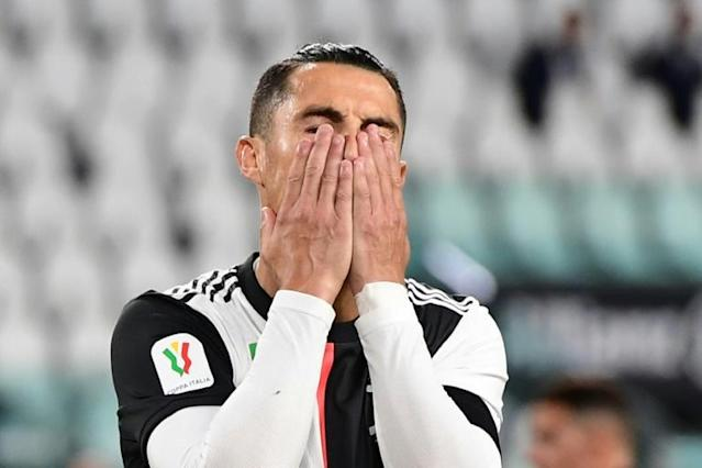 Everyone is looking: Cristiano Ronaldo missed a penalty as Juventus eliminated AC Milan before a huge TV audience as Italian football returned (AFP Photo/Miguel MEDINA)
