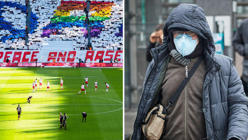 Football players (pictured left) during the match between RB Leipzig and Bayern Leverkusen and a man walking with a mask.