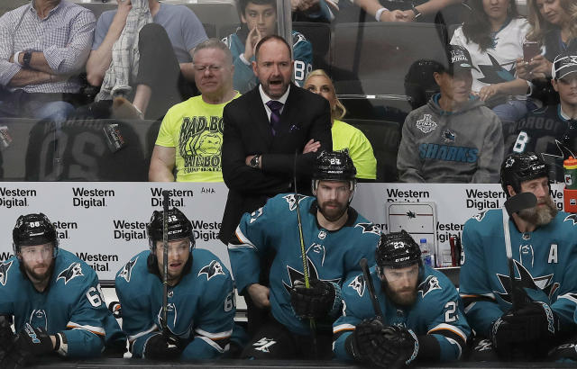 San Jose Sharks head coach Peter DeBoer, center, watches during the third period of Game 7 of an NHL hockey second-round playoff series against the Colorado Avalanche in San Jose, Calif., Wednesday, May 8, 2019. (AP Photo/Jeff Chiu)