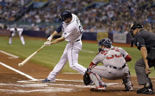 Tampa Bay Rays' Matt Joyce lines an RBI single off Boston Red Sox starting pitcher John Lackey during the first inning of a baseball game Saturday, July 26, 2014, in St. Petersburg, Fla. Rays' Desmond Jennings scored on the hit. Catching for the Red Sox is Christian Vazquez. The home plate umpire is Chad Fairchild. (AP Photo/Chris O'Meara)