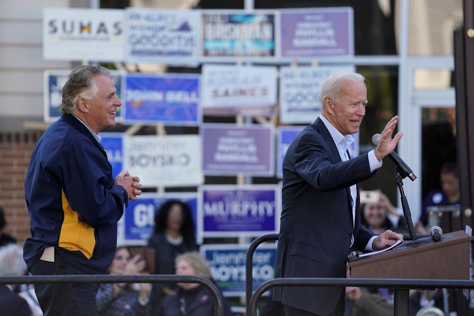 """Democratic presidential candidate and former Vice President Joe Biden, accompanied by former Virginia Governor Terry McAuliffe, speaks at a """"Get out the Vote"""" event in Sterling, Virginia, U.S., November 3, 2019. REUTERS/Aaron P. Bernstein"""