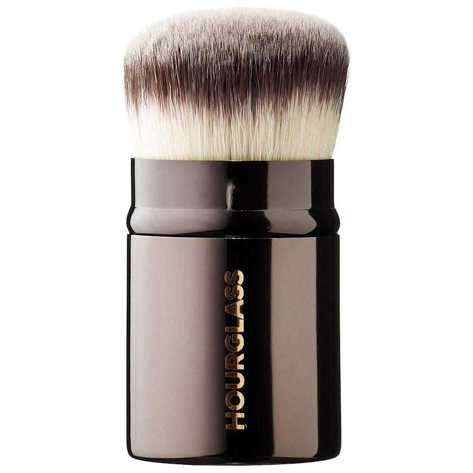 """<p><strong>Hourglass</strong></p><p>sephora.com</p><p><strong>$56.00</strong></p><p><a href=""""https://go.redirectingat.com?id=74968X1596630&url=https%3A%2F%2Fwww.sephora.com%2Fproduct%2Fretractable-kabuki-brush-P376091&sref=https%3A%2F%2Fwww.cosmopolitan.com%2Fstyle-beauty%2Fbeauty%2Fg34552138%2Fbest-kabuki-brushes%2F"""" rel=""""nofollow noopener"""" target=""""_blank"""" data-ylk=""""slk:Shop Now"""" class=""""link rapid-noclick-resp"""">Shop Now</a></p><p>Part of what makes kabuki brushes so great is their compact size that makes them easy to stick in your bag for touch-ups. But there's something even cooler about a retractable brush like this one—you can <strong>control the density of the bristles by sliding the adjustable metal handle up and down</strong>. For more precision, pull the handle up to tighten the bristles and pull it down for fluffier bristles when dusting <a href=""""https://go.redirectingat.com?id=74968X1596630&url=https%3A%2F%2Fwww.sephora.com%2Fproduct%2Ftranslucent-loose-setting-powder-P109908&sref=https%3A%2F%2Fwww.cosmopolitan.com%2Fstyle-beauty%2Fbeauty%2Fg34552138%2Fbest-kabuki-brushes%2F"""" rel=""""nofollow noopener"""" target=""""_blank"""" data-ylk=""""slk:loose powders"""" class=""""link rapid-noclick-resp"""">loose powders</a>.</p>"""