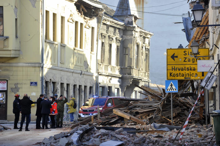 A street is covered by debris from buildings damaged in an earthquake in Petrinja, Croatia, Tuesday, Dec. 29, 2020. A strong earthquake has hit central Croatia and caused major damage and at least one death and 20 injuries in a town southeast of the capital Zagreb. (AP Photo)