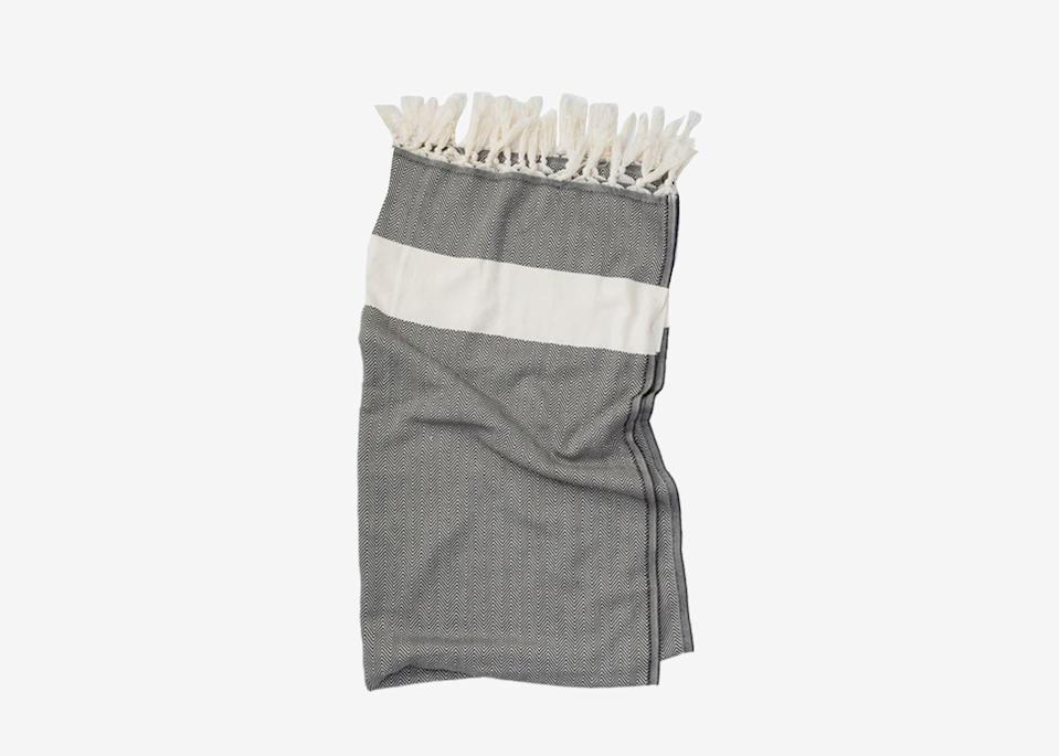 """<p>A lightweight towel comes in handy during any number of road trip situations: Use it for spontaneous swims, roadside picnics, or as a buffer between the hot leather seat and your legs in the car. This extra-smooth Turkish cotton towel is as absorbent as a standard bath towel but much more compact. If you're looking for something thicker to sit on at the beach, lakeside, or in a park, this <a href=""""https://click.linksynergy.com/deeplink?id=mcB7N8bf3MY&mid=1237&u1=roadtripessentials&murl=https%3A%2F%2Fshop.nordstrom.com%2Fs%2Flittle-unicorn-outdoor-blanket%2F5320133"""" rel=""""nofollow noopener"""" target=""""_blank"""" data-ylk=""""slk:foldable outdoor blanket"""" class=""""link rapid-noclick-resp"""">foldable outdoor blanket</a> will give you a bit more padding.</p> <p><strong>Buy now:</strong> <a href=""""https://fave.co/3e9Iapc"""" rel=""""nofollow noopener"""" target=""""_blank"""" data-ylk=""""slk:$24, huckberry.com"""" class=""""link rapid-noclick-resp"""">$24, huckberry.com</a></p>"""