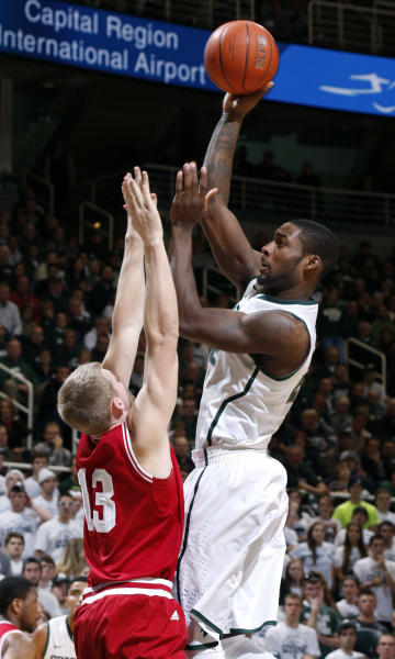 Michigan State's Branden Dawson, right, shoots over Indiana's Austin Etherington (13) during the second half of an NCAA college basketball game, Tuesday, Jan. 21, 2014, in East Lansing, Mich. Michigan State won 71-66. (AP Photo/Al Goldis)