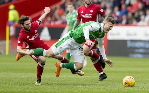 "Words cannot break bones, unlike dangerous tackles, but Scott Brown's verdict on Graeme Shinnie might leave the Aberdeen captain feeling stung, to say the least. Shinnie was cautioned on Sunday for a late lunge at his Celtic counterpart during the Dons' first victory at Parkhead in 14 years, but afterwards added that 'what goes around, comes around.' Brown was in celebratory mood on Tuesday as he collected his latest prize, the Ladbrokes Scottish Premiership Player of the Season trophy, to add to the equivalent accolades bestowed by PFA Scotland and the Scottish Football Writers' Association, but his combative tendency was also in evidence when Shinnie's name came up. ""The ankle's fine. It takes more than that to keep me down,"" Brown said. ""It was a Graeme Shinnie tackle. It sums him up really. ""He was saying that he got close to the ball, but I watched it back and it is kind of a little boy's tackle – waiting until I was past him. My pace obviously did him in his prime and I got past him. I'm not the one with 15 league bookings this season. ""Graeme runs about, he tackles, stuff like that. He's not got great quality, but he does the best he possibly can. It's the only thing he can probably do to try and stop us – to try and make a bad tackle. To be fair on him, it was a good bad tackle. Brown has won numerous personal awards this season Credit: getty images ""My ankle has got no ligaments left in it. It kind of locked. I just needed to open it up again. As soon as I got up. I felt it quite high up. I was thinking, 'Thank goodness I still wear those grandad shinpads that come all the way around and protect everything!' ""It wasn't too bad. I have had worse, but it wasn't great, especially at the time of year."" Shinnie's challenge will not, however, prevent Brown from facing Motherwell in the William Hill Scottish Cup final at Hampden Park on Saturday. If Celtic fulfil their status as emphatic odds-on favourites to take the trophy, Brown will collect his 14th honour as captain and gain the distinction of having worn the armband through an unprecedented sequence of consecutive clean sweeps of the Scottish honours. ""It's not been done before,"" he said. ""A lot of people doubted our ability to go through the season and do the exact same thing again because it was always going to be hard. It was always going to come to a time where we got beaten in a game or we struggled. ""Hearts managed to get that victory. It was about how we bounced back. We have won two trophies and we have got a chance to win a third. We need to make sure we do it for ourselves."" Celtic and Motherwell have already contested one of the season's prizes, when they met in the Betfred Scottish League Cup final at the same venue in November. Celtic's acquired their 101st trophy with a 2-0 victory and, although Motherwell have a name for being robust, Brown views them in a more favourable light than he does Shinnie. Shinnie (left) has been booked more times than any other player in Scotland this season Credit: getty images ""We know how they play - they are physical but they are very fair,"" he said. ""They use their bodies and they don't lunge in to tackles or do stupid challenges. It's up to the striker and they play off second balls. We've got that in our locker as well. ""They are very direct that way but that's how their team is shaped out and everyone knows their job. They defend really well. In the semi-final against Aberdeen they showed their qualities as well, especially in the first half. ""It's a huge weekend. I'm looking forward to it. We've had a couple of days' rest and recovery, that's been good and now we'll start working properly, focusing on the game, set-plays, what we're going to do, what shape we're going to play and what team we'll play as well."" Fans of rival clubs frequently deride Brown as a headbanger. As it happens, his skull has been in contact with silverware more than once. ""Well, I did drop the League Cup on my head two years in a row,"" he confessed. ""Last year I had no excuse, this year I caught my finger and everyone else jumped and it smacked me on my forehead. You'd think I'd get used to it after picking up a few."""