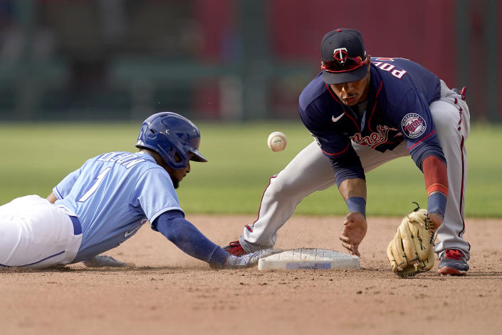 Kansas City Royals' Jarrod Dyson beats the tag by Minnesota Twins second baseman Jorge Polanco as he dove back to second on a ground out hit into by Jorge Soler during the ninth inning of a baseball game Saturday, June 5, 2021, in Kansas City, Mo. The Twins won 5-4. (AP Photo/Charlie Riedel)