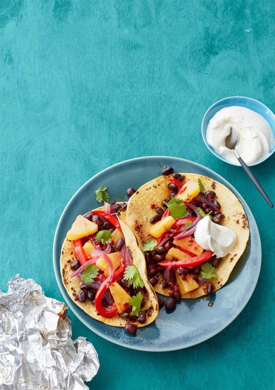 """<p>Mexican goes meatless with these sweet and smoky vegetarian fajitas.</p><p><a href=""""https://www.womansday.com/food-recipes/food-drinks/recipes/a55780/potsticker-stir-fry-recipe/"""" rel=""""nofollow noopener"""" target=""""_blank"""" data-ylk=""""slk:Get the Pineapple and Black Bean Fajitas recipe."""" class=""""link rapid-noclick-resp""""><em>Get the Pineapple and Black Bean Fajitas recipe.</em></a></p>"""