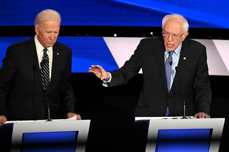 (L-R) Democratic presidential hopefuls Former Vice President Joe Biden (L) and Vermont Senator Bernie Sanders participate in the seventh Democratic primary debate of the 2020 presidential campaign in Des Moines, Iowa on Jan. 14, 2020. | Robyn Beck—AFP via Getty Images