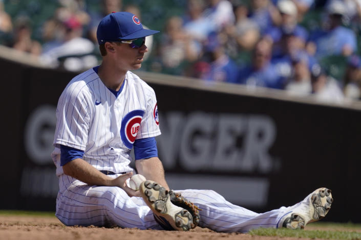 Chicago Cubs second baseman Matt Duffy sits on the field after Kansas City Royals' Andrew Benintendi hit a two-run double in the third inning of a baseball game Sunday, Aug. 22, 2021, in Chicago. (AP Photo/Nam Y. Huh)
