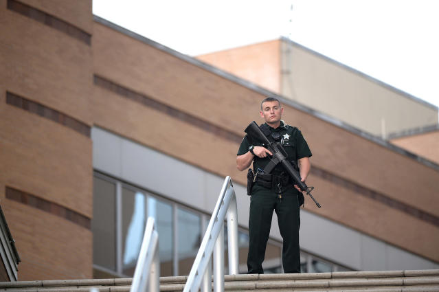 <p>A police officer stands guard outside the Orlando Regional Medical Center hospital after a fatal shooting at a nearby Pulse Orlando nightclub in Orlando, Fla., Sunday, June 12, 2016. (AP Photo/Phelan M. Ebenhack) </p>