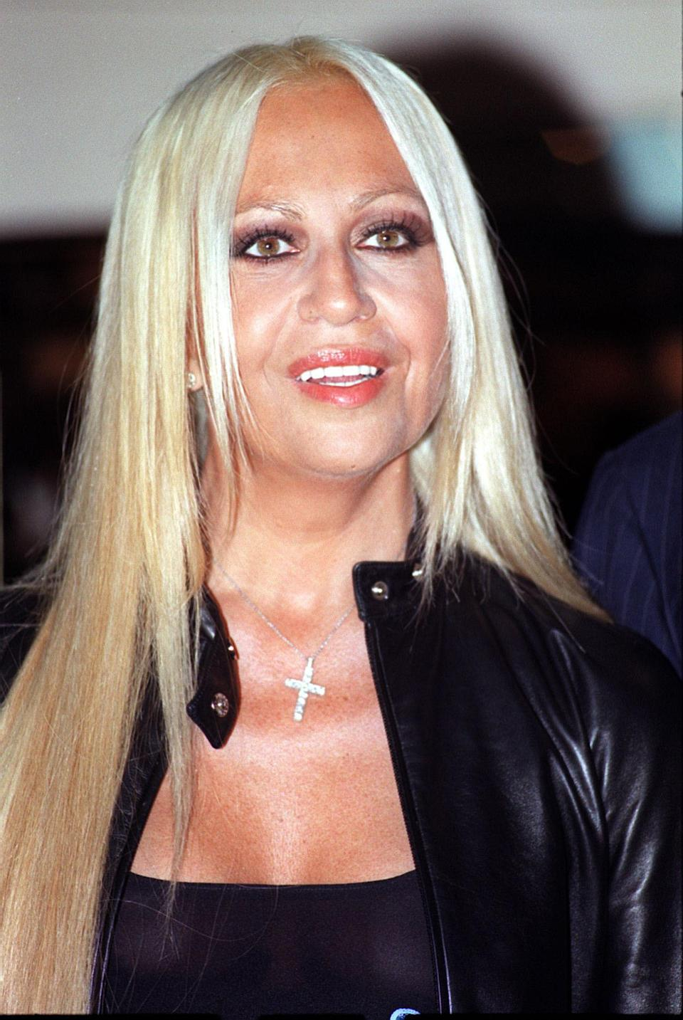 <p>By this time, Donatella had taken the helm at Versace and was preparing for her first London show. She appears to have started some cosmetic work with her face appearing tighter than before. <i>[Photo: PA]</i> </p>