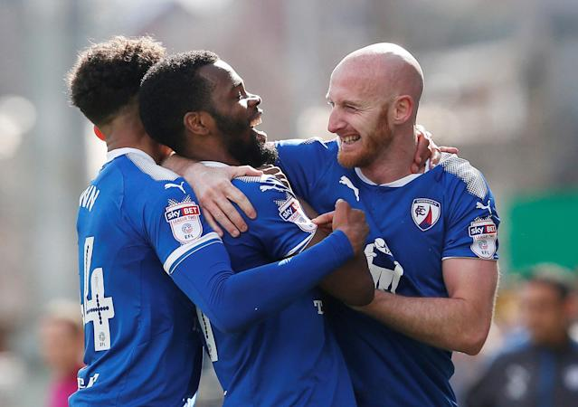 "Soccer Football - League Two - Chesterfield vs Notts County - Proact Stadium, Chesterfield, Britain - March 25, 2018 Chesterfield's Zavon Hines celebrates scoring their second goal with team mates Action Images/Craig Brough EDITORIAL USE ONLY. No use with unauthorized audio, video, data, fixture lists, club/league logos or ""live"" services. Online in-match use limited to 75 images, no video emulation. No use in betting, games or single club/league/player publications. Please contact your account representative for further details."