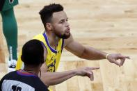 Golden State Warriors' Stephen Curry reacts after making a three-point basket during the second half of an NBA basketball game against the Boston Celtics, Saturday, April 17, 2021, in Boston. (AP Photo/Michael Dwyer)
