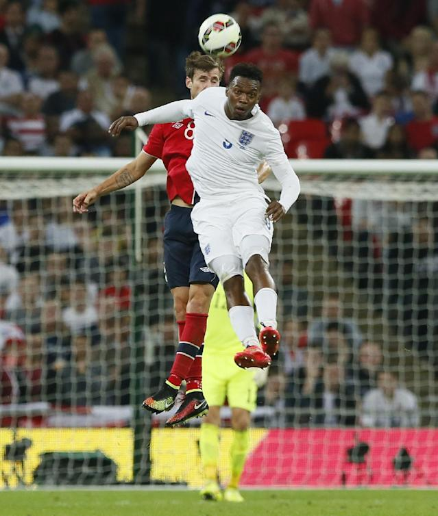 England's Daniel Sturridge, front, jumps for the ball with Norway's Harvard Nordtveit during the international friendly soccer match between England and Norway at Wembley Stadium in London, Wednesday, Sept. 3, 2014. (AP Photo/Alastair Grant)