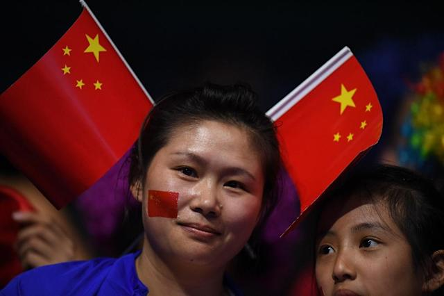 """Official government media in China now argue that a """"majority"""" of Chinese fans are learning to enjoy sports as sports rather than a contest for national pride (AFP Photo/Jim Watson)"""