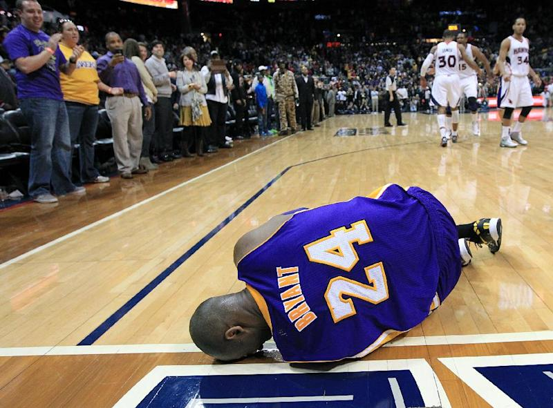 Los Angeles Lakers guard Kobe Bryant lays on the floor after being injured in the final seconds of an NBA basketball game against the Atlanta Hawks on Wednesday, March 13, 2013, in Atlanta. The Hawks defeated the Lakers 96-92. (AP Photo/Atlanta Journal-Constitution, Curtis Compton)
